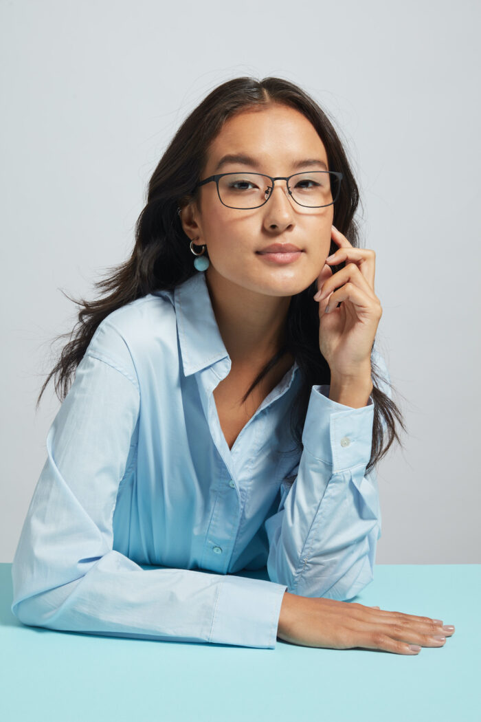 A woman modelling Covry glasses
