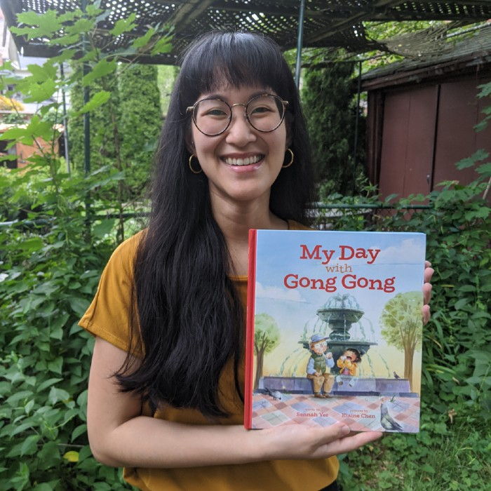 Author Sennah Yee holding a copy of her children's book, 'My Day With Gong Gong'