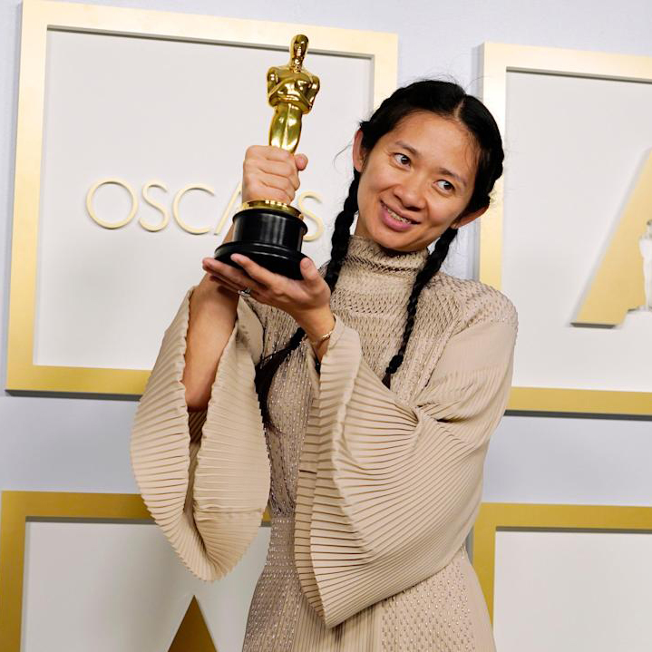 Chloé Zhao poses after winning the Academy Award for Best Picture for Nomadland (